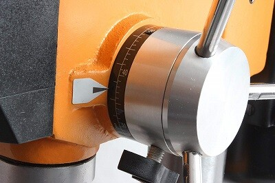 Depth setting on drill press for wood drilling